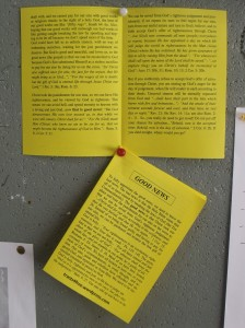 tract displayed open on a notice board.