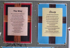 Evangelism posters displayed on a public noticeboard.
