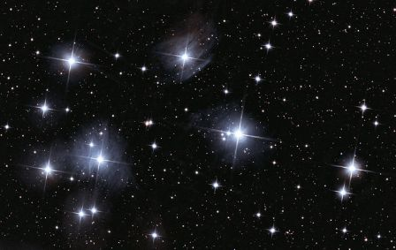 The Pleiades, a cluster of stars or constellation.