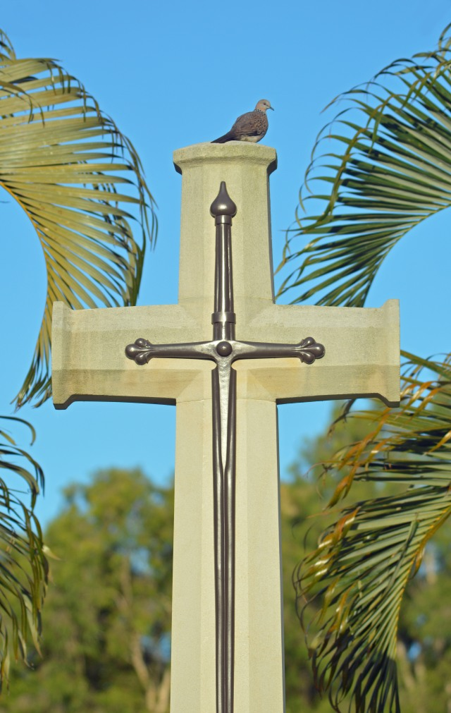 A dove sitting on top of a cross. I like the symbolism, with the cross representing salvation through Jesus Christ, and the dove is a symbol of the Holy Spirit. The dove is also a symbol of peace, and this cross is in the war cemetery in Cairns, Australia. Photo: David Clode.